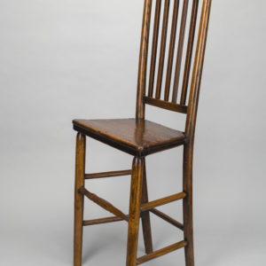 Wooden chair with spindles on the back.