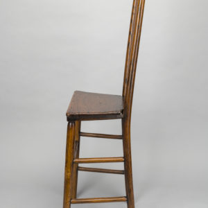 Side view of a wooden chair.