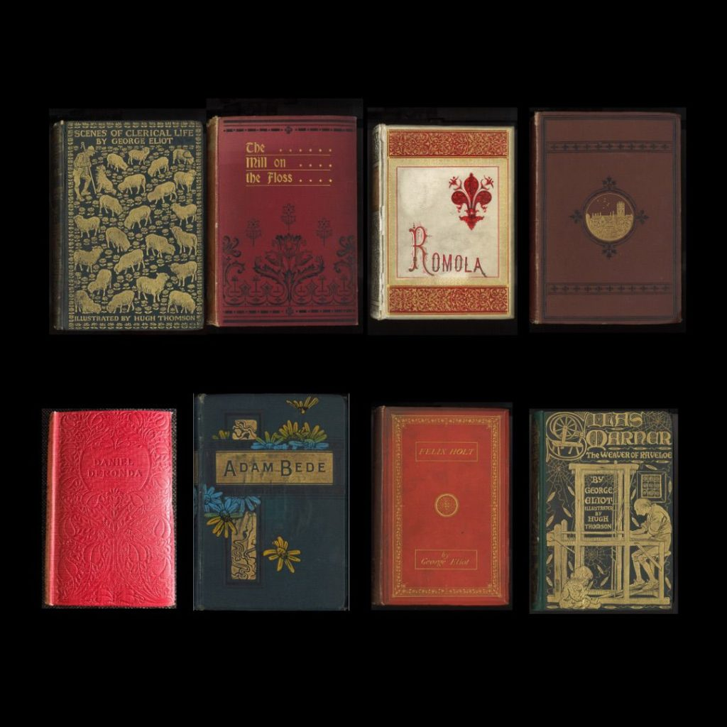 Group of eight books on a black background.
