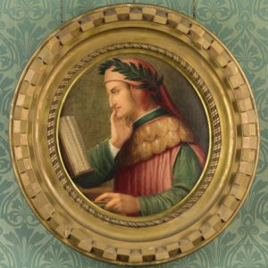 Circular watercolour painting. It is surrounded by a ornate gold frame. The painting shows a man from the side. He is reading a book with the right side of his chin resting on his right hand. He has a red head covering on top of which is a green leaf crown. He wears a red tabard with green sleeves.