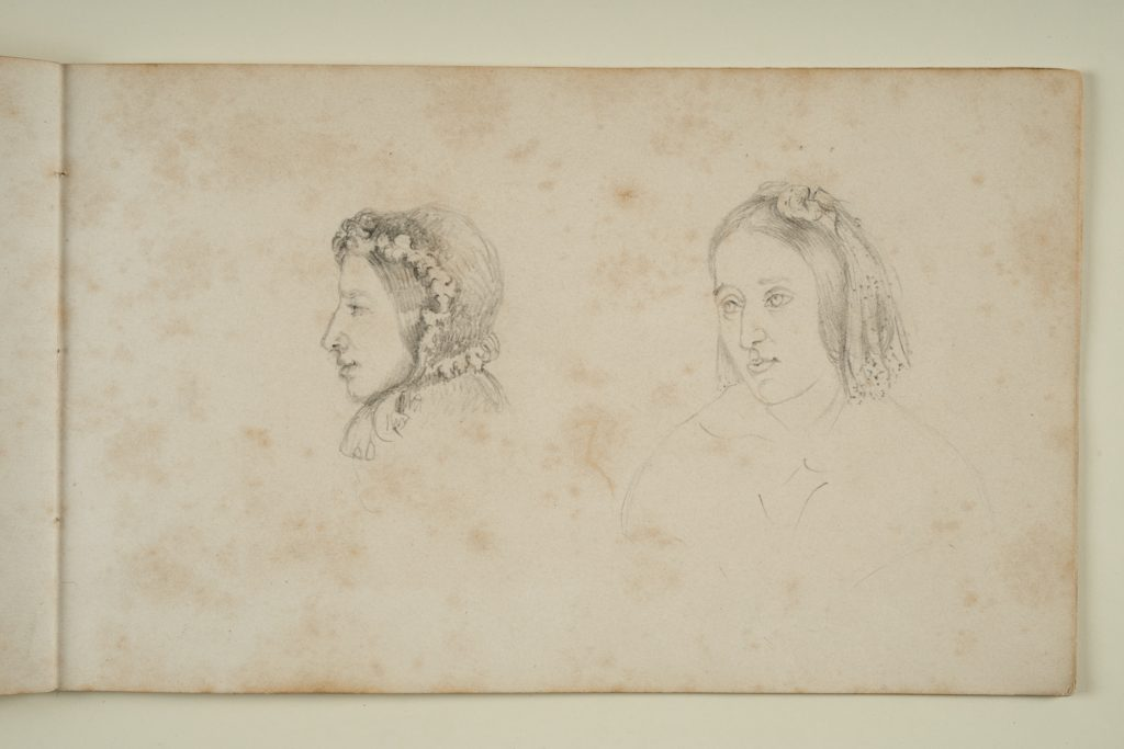 Page from a sketchbook showing two pencil sketches of women. One is a side view of a woman wearing a bonnet. The other shows a woman with a covering over the back of her head.