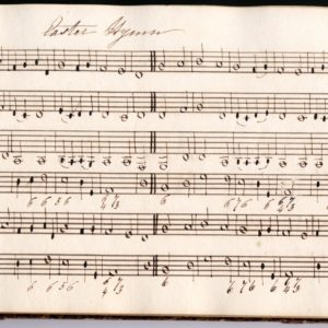 Page from a music book. There are lines across the page and musical notes written onto them.