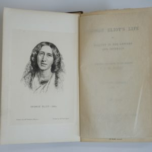 Pages from an open book. The left hand side shows a portrait of George Eliot. The right hand side page is obscured by an inner cover. It reads George Eliot's Life as related in her letters and journals. Arranged and edited by her husband J.W Cross in three volumes.