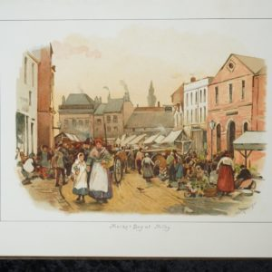 An colour illustration showing a bustling market scene with covered stalls and lots of people. In the foreground is a woman and child wearing bonnets and aprons and carrying baskets. The words Market Day at Milby are shown at the bottom with the signature G.G.Kilburne.