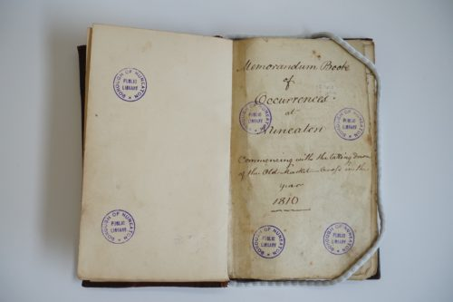 Book open at first page. Handwritten text reads: 'Memorandum book of occurrences at Nuneaton. 1810.