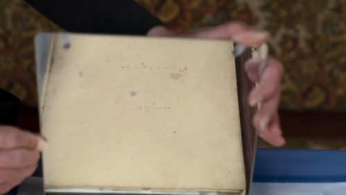 Image of a cream cultured sheet of member viewed through a mirror. The signature ME Lewes can be faintly seen.