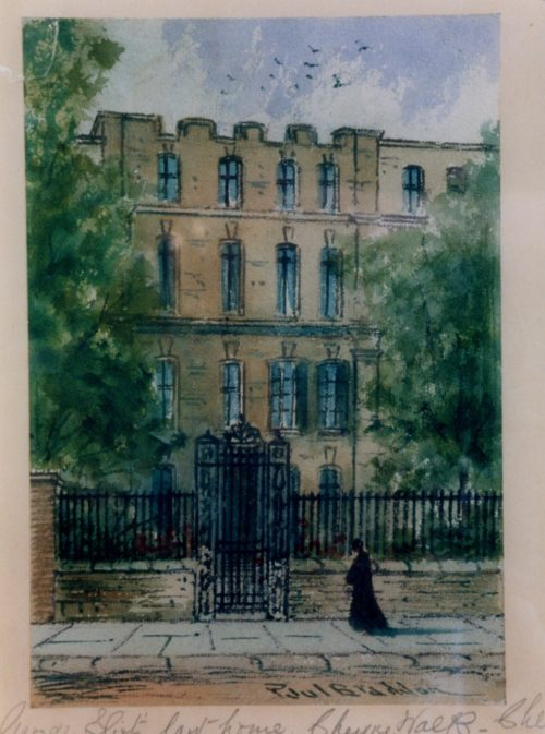 Watercolour painting showing a large housing block with numerous windows. There are trees to the left and right of the house. A metal gate surrounds the front and a figure stnads before a grand gate. There is a blue sky with clouds and birds flying overhead. The following is handwritten in pencil: 'George Eliot's last home. Cheyne Walk, Chelsea.