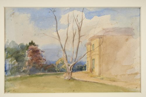 Watercolour painting showing the side of a large house on the right hand side. A tree with bare branches is on a lawn in front of the trees and green and brown trees are on the left hand side. Blue sky and clouds are overhead.