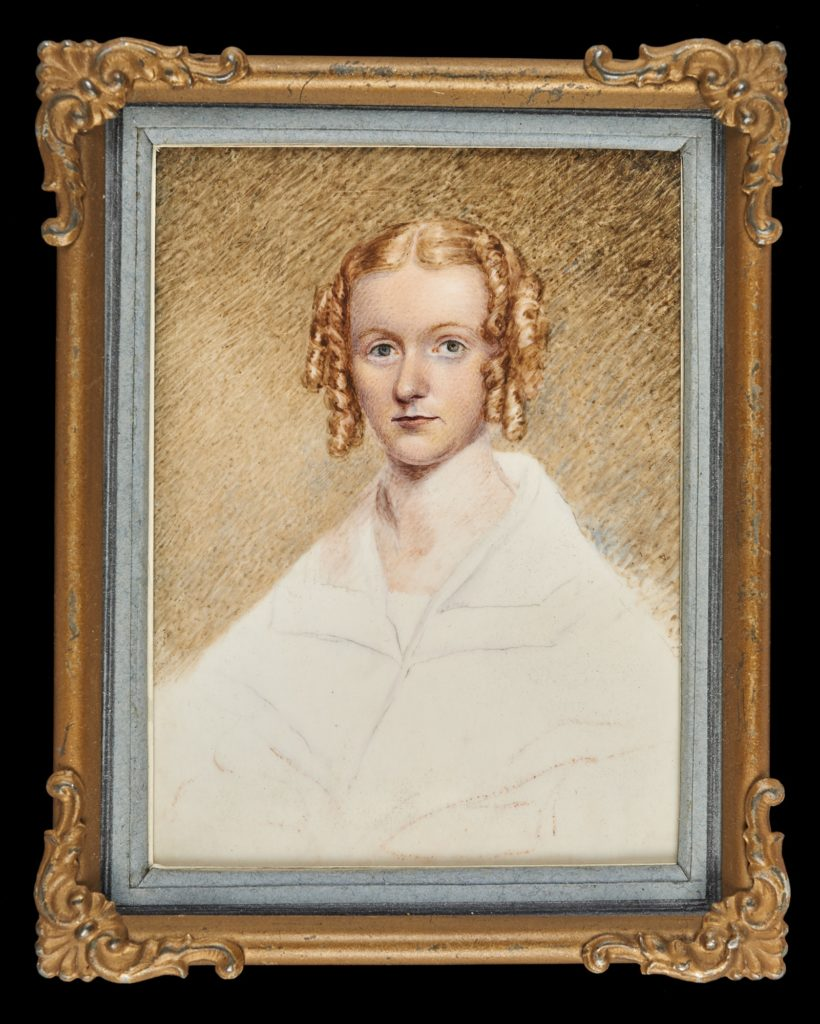 Painting of a woman with side ringlets dressed in white. In gilt brass (gilt now missing) frame.