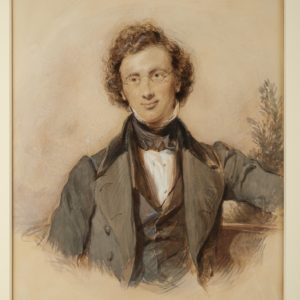 Watercolour painting of Charles Christian Hennell. Shows a man. He is wearing glasses, a high collar, shirt, waistcoat and jacket. On the right hand side is a plant or tree.